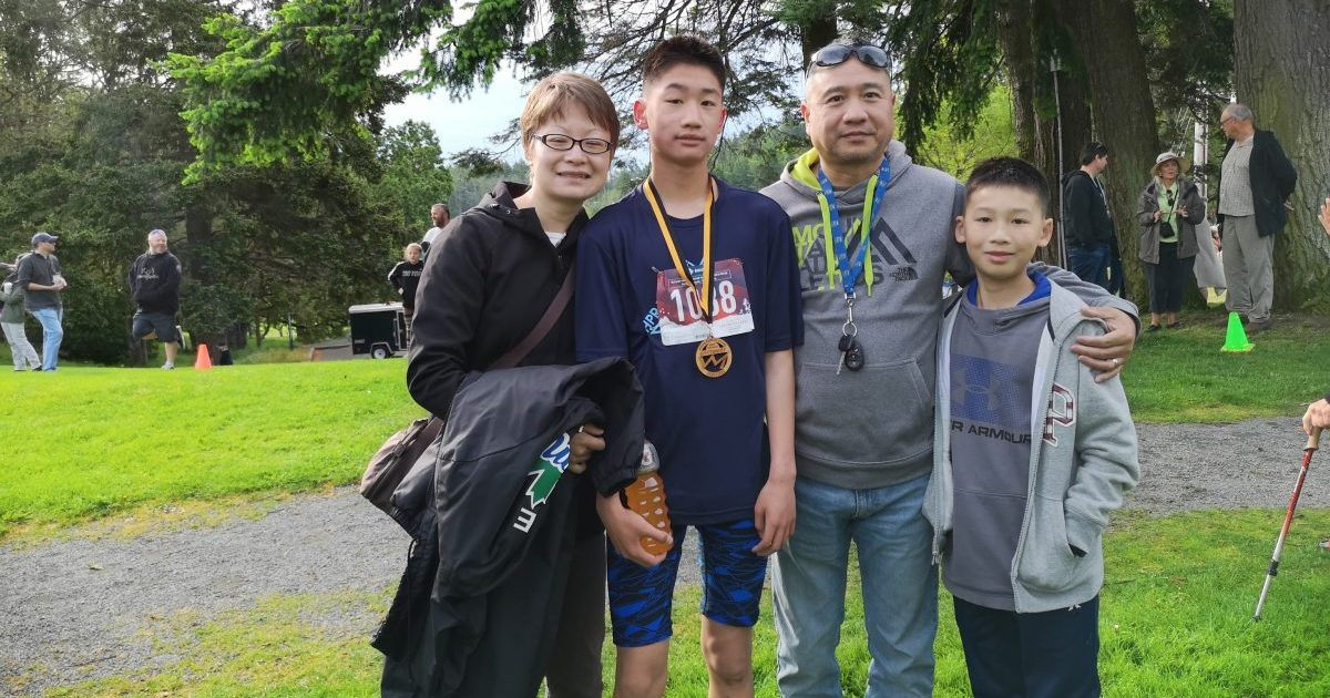 A family poses with their youth athletes.